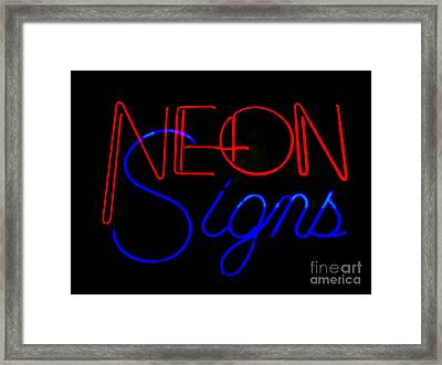 Neon Signs In Black Framed Print by Kelly Awad