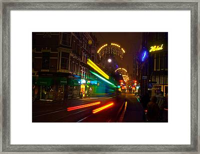 Framed Print featuring the photograph Neon Tram Leidestraat by Jonah  Anderson
