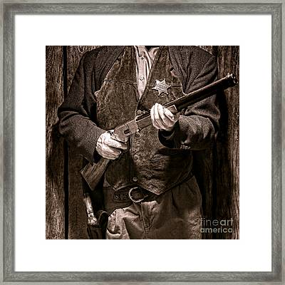New Sheriff In Town  Framed Print by Olivier Le Queinec