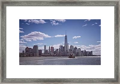 New York Skyline And Boat Framed Print