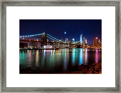 Framed Print featuring the photograph New York Skyline And Brooklyn Bridge With Crescent Moon Rising by Mitchell R Grosky
