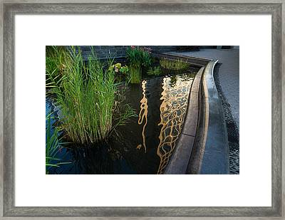 New York Skyscrapers Reflecting In A Beautiful Little Fountain With Flowers Framed Print by Georgia Mizuleva