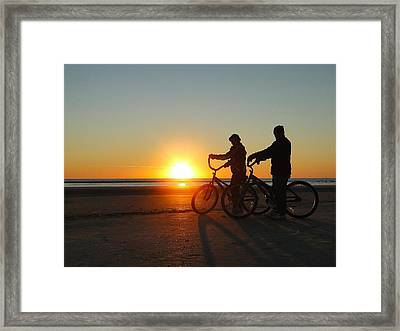 Newlyweds Pause To Embrace The Sunrise Framed Print