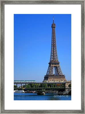 Next Stop Eiffel Tower Framed Print by Olivier Le Queinec