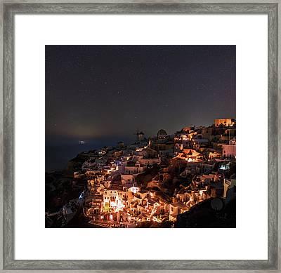 Night Sky Over Oia Framed Print by Babak Tafreshi