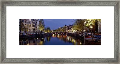 Night View Along Canal Amsterdam The Framed Print by Panoramic Images