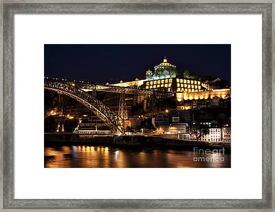 Nighttime In Porto Framed Print by John Rizzuto