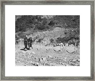 North Korean Massecre Graves Framed Print by Underwood Archives