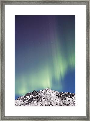 Northern Lights Above The Snow Covered Framed Print by Kevin Smith