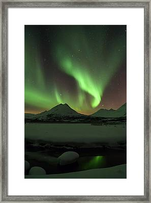 Northern Lights Over Frozen Lake Troms Framed Print by Sandra Schaenzer