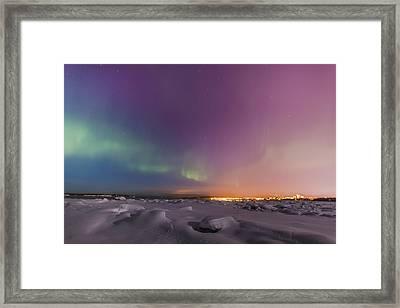 Northern Lights Shine Above City Framed Print