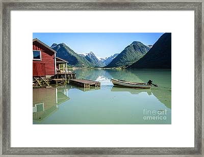 Reflection Of A Boat And A Boathouse In A Fjord In Norway Framed Print by IPics Photography