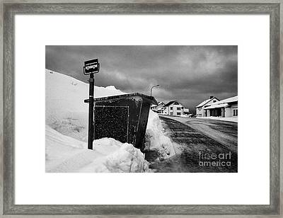 norwegian bus stop shelter covered in snow by the side of the road Honningsvag finnmark norway europ Framed Print