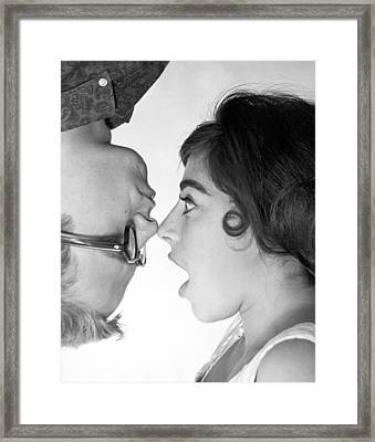Nose To Nose Framed Print by Underwood Archives