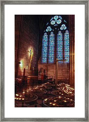 Notre Dame Candles Framed Print by Ross Henton