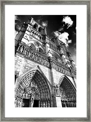 Notre Dame De Paris Framed Print by John Rizzuto