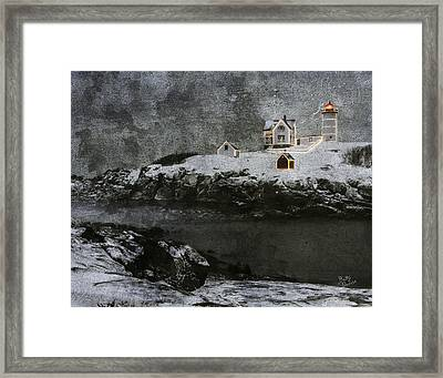 Nubble Light Stormy Night Framed Print by Betty Denise