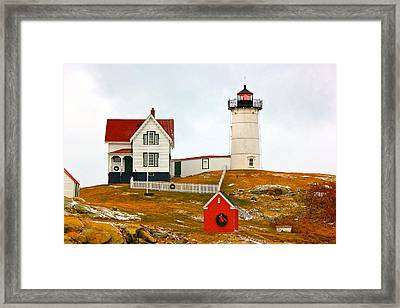 Framed Print featuring the photograph Nubble Lighthouse by Amazing Jules