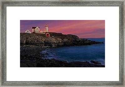 Nubble Lighthouse At Sunset Framed Print by Susan Candelario