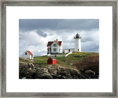 Nubble Lighthouse Framed Print by Nancy Landry
