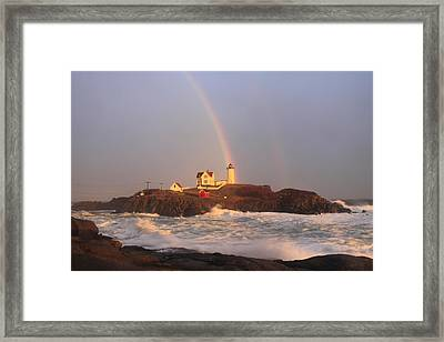 Nubble Lighthouse Rainbow And High Surf Framed Print by John Burk