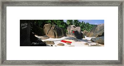 Nudist Corner Written On A Rock Framed Print