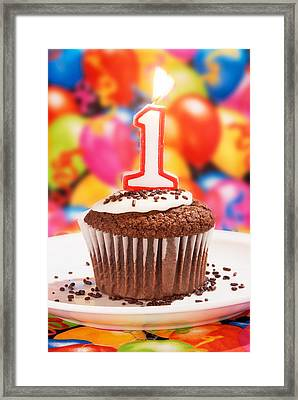 Framed Print featuring the photograph Chocolate Cupcake With One Burning Candle by Vizual Studio