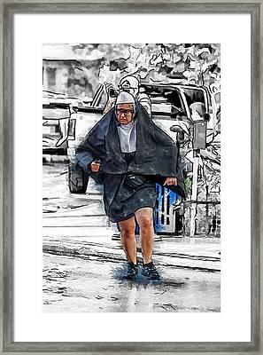 Nun On The Run Framed Print by John Haldane