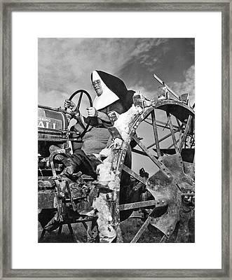 Nun Runs Tractor On Farm Framed Print by Underwood Archives