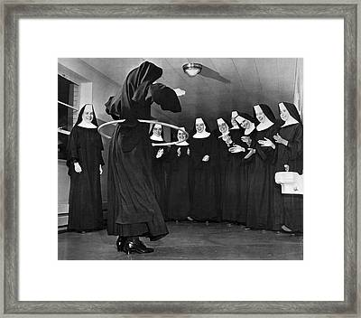 Nun Swivels Hula Hoop On Hips Framed Print by Underwood Archives