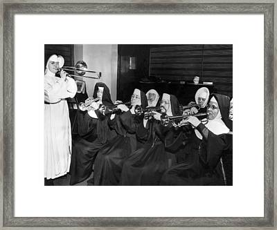 Nuns Rehearse For Concert Framed Print by Underwood Archives