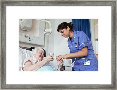 Nurse And Patient On Hospital Ward Framed Print