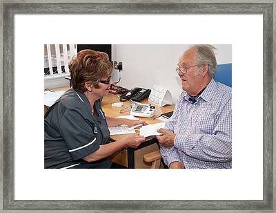 Nurse Consulation Framed Print by Life In View/science Photo Library