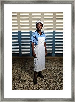 Nurse In Sierra Leone Framed Print by Matthew Oldfield