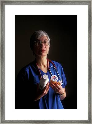 Nurse With Anti-hiv Medications Framed Print by Jim West