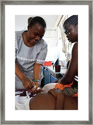 Nursing In Sierra Leone Framed Print