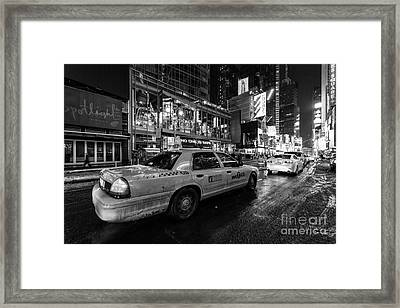 Nyc Cab Times Square Framed Print by John Farnan