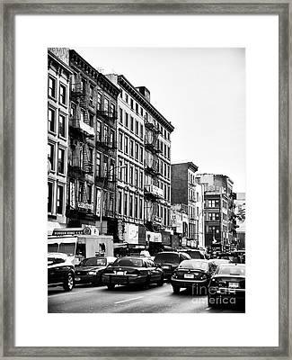 Nyc Traffic Framed Print by John Rizzuto