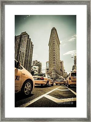 Nyc Yellow Cabs At The Flat Iron Building - V1 Framed Print by Hannes Cmarits