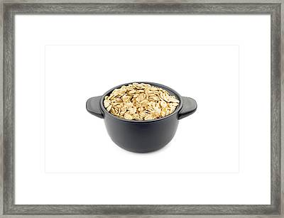 Oat Flakes In A Black Cup Framed Print by Alain De Maximy