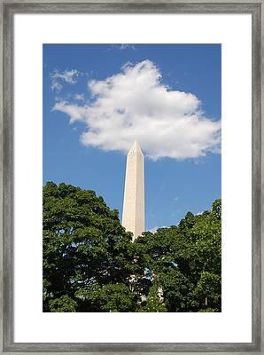 Obelisk Rises Into The Clouds Framed Print