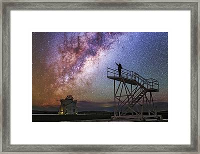 Observer Pointing At The Milky Way Framed Print by Babak Tafreshi