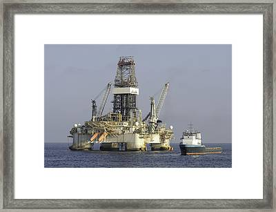 Framed Print featuring the photograph Ocean Oil Rig With Supply Boat by Bradford Martin