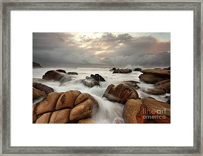 Ocean Surges Over Weathered Rocks Framed Print by Leah-Anne Thompson