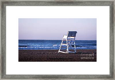 Off Duty Framed Print by John Rizzuto