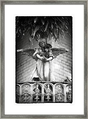 Offering In New Orleans Framed Print by John Rizzuto
