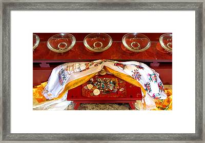 Framed Print featuring the photograph Offerings At The Foot Of The Buddha by Brenda Pressnall