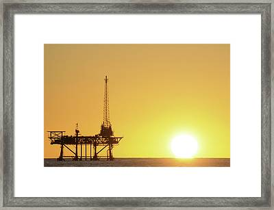 Offshore Oil Rig And Sun Framed Print