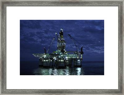 Offshore Oil Rig At Night Framed Print