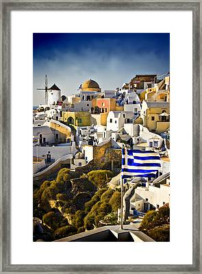 Oia And A Greek Flag Framed Print by Meirion Matthias